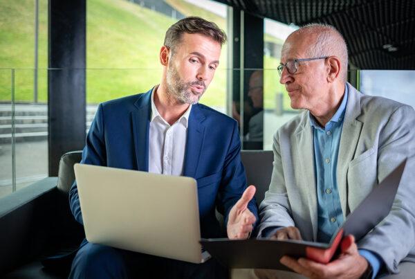 Business men discussing finances